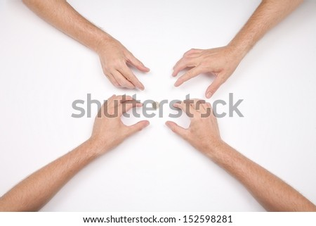hand of four men and a coin of 1 euro on white background - stock photo