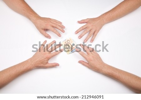 hand of four men and wad of euros on white background - stock photo