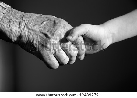 hand of grandmother and grandchild  - stock photo