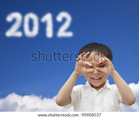 hand of happy kid make telescope shape  and watching the cloud 2012 - stock photo
