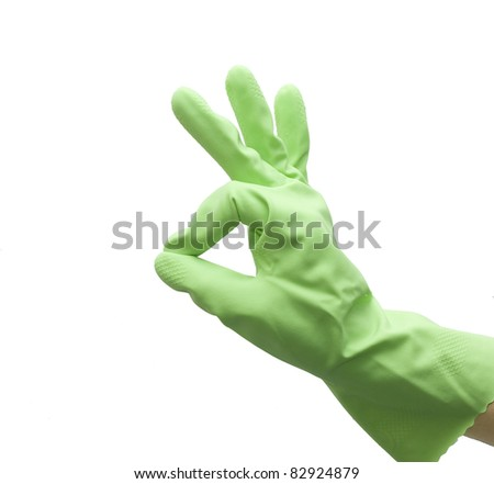 Hand of housewife in a green kitchen glove gesturing OK isolated on white background - stock photo