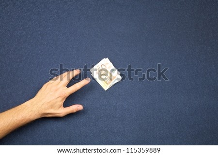 hand of man and wad of euros on white background - stock photo