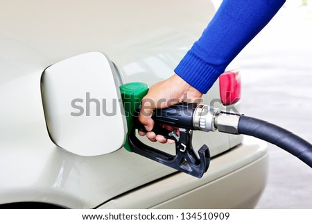 Hand of man. Are fueling the car - stock photo