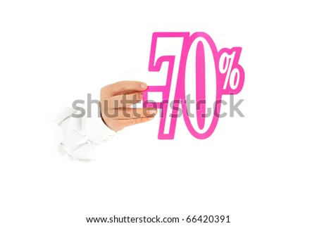 Hand of man breaking through a paper wall showing seventy percent discount sign. Copy space. Studio shot. White background. - stock photo