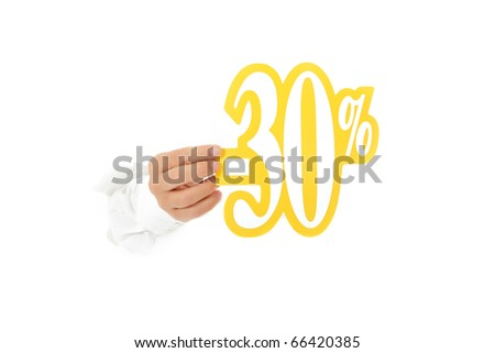 Hand of man breaking through a paper wall showing thirty percent discount sign. Copy space. Studio shot. White background. - stock photo