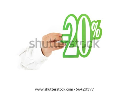 Hand of man breaking through a paper wall showing twenty percent discount sign. Copy space. Studio shot. White background. - stock photo