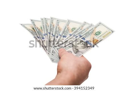 hand of man holding fanned fistful dollars bills - stock photo