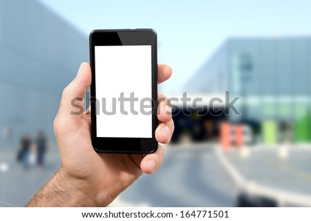 hand of man is in possession of mobile smartphone with touch screen which incorporates a qr code with your camera - stock photo