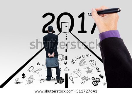Hand of manager drawing sketch and his partner looking at door with numbers 2017 while standing on doodles of business