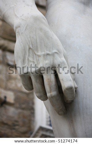 Hand of Michelangelo's David - stock photo