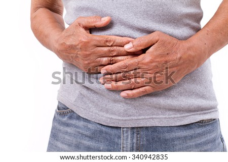 hand of old man holding stomach suffering from pain, diarrhea, indigestive problem - stock photo