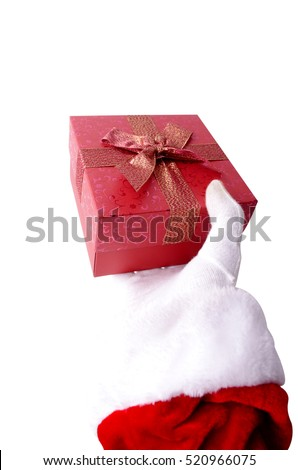 Hand of santa claus holding a gift on white background
