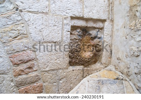 Hand of Saviour on Station Five of Via dolorosa (Way of Suffer) in Jerusalem - stock photo
