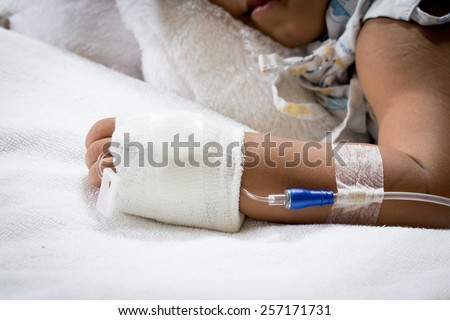 hand of sick little girl in hospital - stock photo