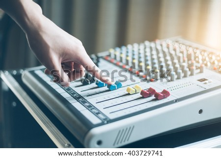 Hand of the audio musical mixer