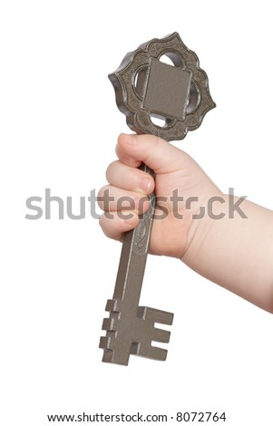 Hand of the baby holding the big key isolated on white background - stock photo