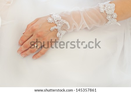 Hand of the bride with wedding ring - stock photo