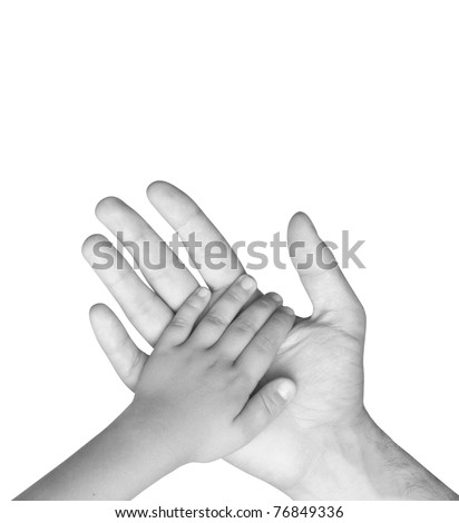 hand of the child in a man's hand