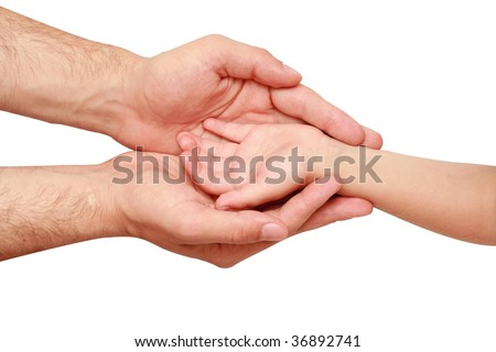 hand of the child in the hands of an adult male - stock photo