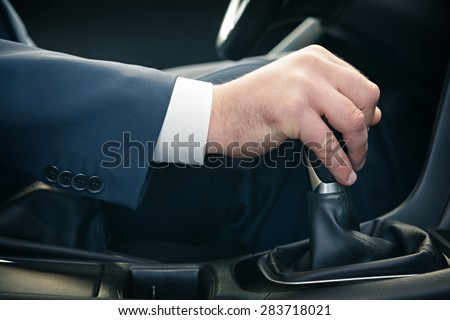 Hand of the driver of the car , toned. - stock photo