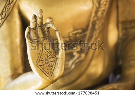 Hand of the golden Buddha 2 - stock photo