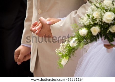 hand of the groom and the bride - stock photo