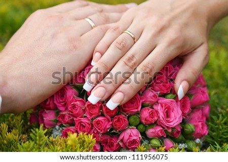 Hand of the groom and the bride  wedding rings - stock photo