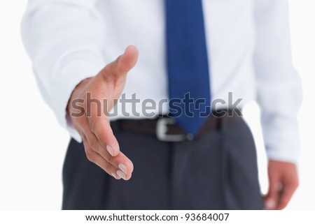Hand of tradesman ready to be shaken against a white background - stock photo