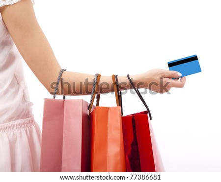 hand of woman holding shopping bags and credit card - stock photo