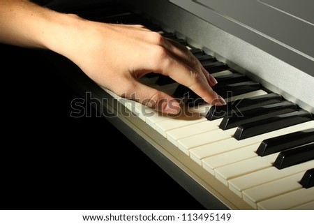 hand of woman playing piano - stock photo