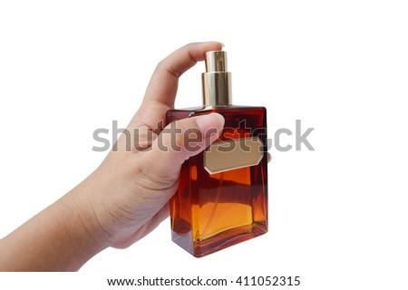 Hand of woman spraying perfume  - stock photo