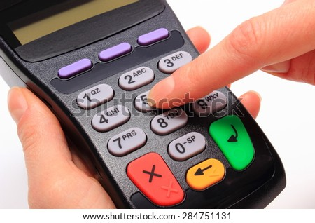 Hand of woman using payment terminal, enter personal identification number, finance concept