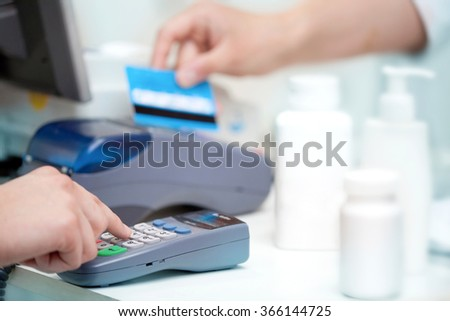 Hand of Woman Using Payment Terminal in an Shop, Paying With Credit Card, Credit Card Reader, Finance Concept  - stock photo