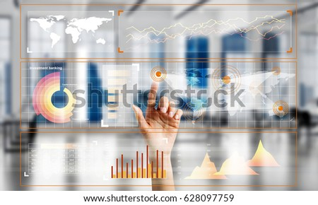 Hand of woman working with media interface on screen and office interior at background