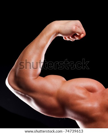 Hand of young man bodybuilder with biceps - stock photo