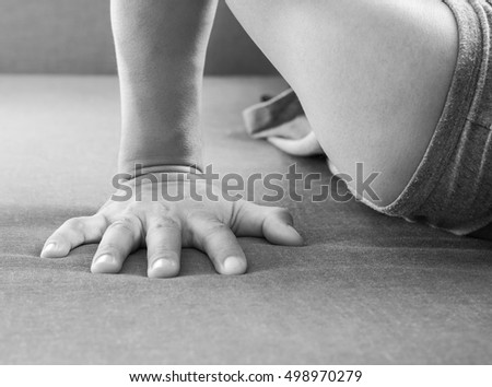 Hand of young man in sportswear doing push-up at gym.