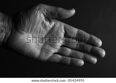 Hand offered in greeting - stock photo