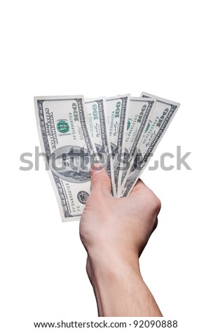 Hand offering five hundred US dollar banknotes isolated on white
