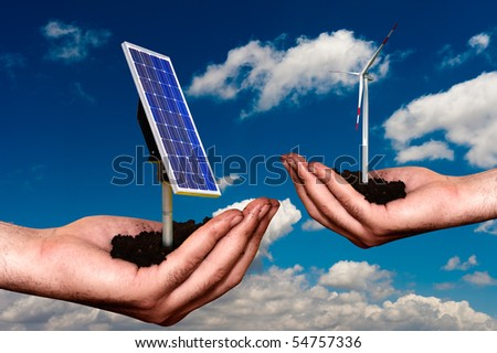 Hand offering renewable energy systems - stock photo