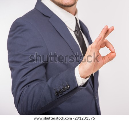 Hand OK sign isolated on white background. Business success concept. - stock photo
