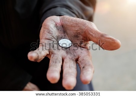 hand old man begging for money because of the hunger in morning light - stock photo