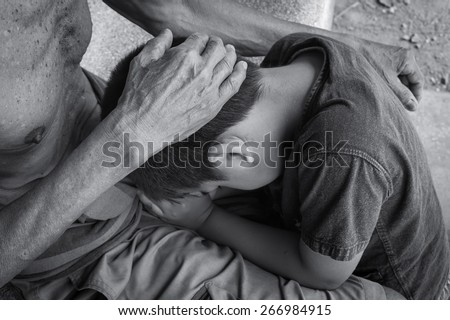 hand old man touches head boy with love  - stock photo