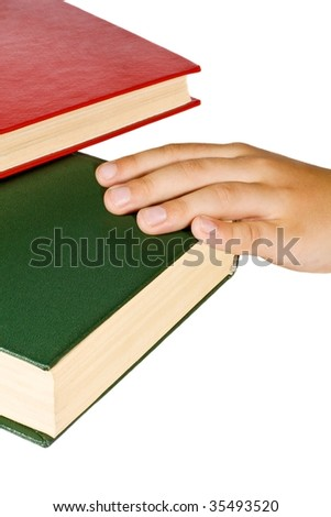 Hand on a green book isolated on white background