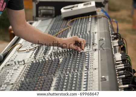 Hand on an audio mixer - stock photo