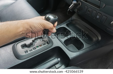 hand on automatic gear Transmission, Man hand shifting an automatic car