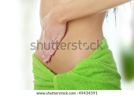 Hand on belly - stock photo