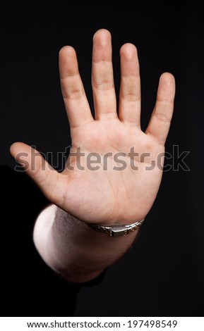 Hand on black background - stock photo