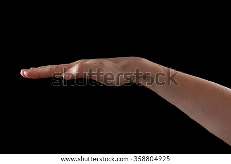 Hand on black background