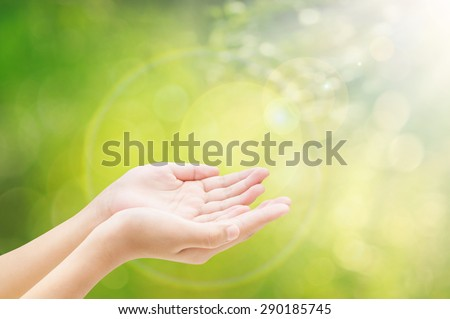 Hand on bokeh background
