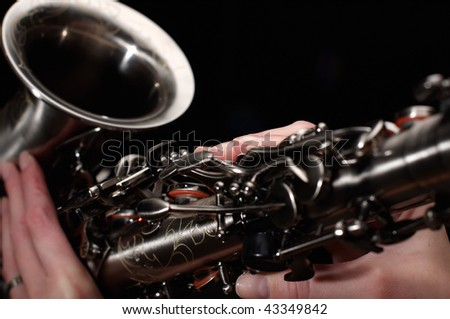 hand on buttons of saxophone - stock photo